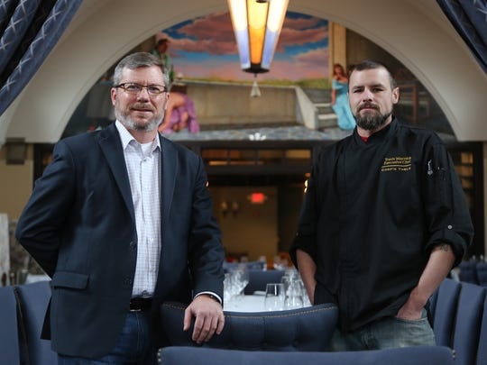 Chef's Table XII general manager Rhett Baugh, 49, left, and executive chef Travis Waynick, 39, pose in the dining room of their forthcoming restaurant, which is opening in the former Tribute restaurant space in Farmington Hills.