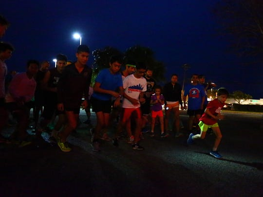 Runners taking part Wednesday in a three-mile run from