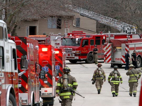 Waukesha firefighters work the scene of a house fire in April 2015. The department's overtime expenses for 2016 came in well under budget, breaking a recent trend for such spending.
