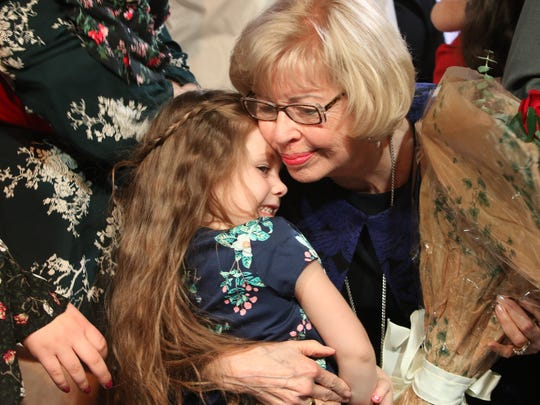 2017 Springfieldian Patti Penny hugs her 4-year-old great-granddaughter  Laightyn Stringer afer accepting the award at the Springfield Area Chamber of Commerce Annual Meeting Friday at the University Plaza.