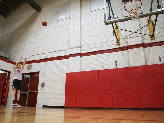 Felicity Graf shoots during a solo workout at Bloomfield High School in Bloomfield, Ind., Wednesday, Jan. 25, 2017.