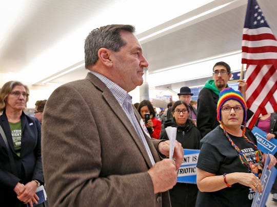 U.S. Sen. Joe Donnelly speaks during a Jan. 29, 2017, protest at Indianapolis International Airport against President Donald Trump's executive orders on immigration.