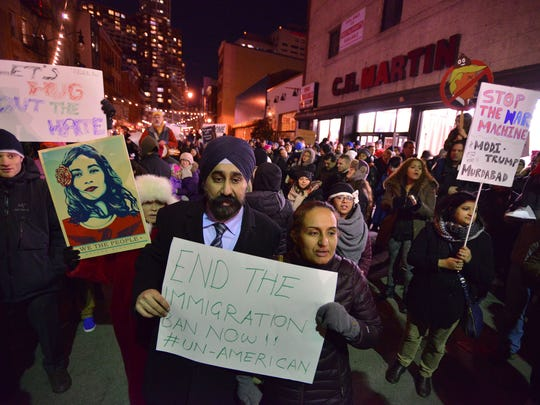 Ravinder S. Bhalla Councilman-at-Large and Council President for the City of Hoboken with his wife Navneet showing their support at the  Rally against refugee, Muslim ban in Jersey City on Monday night.