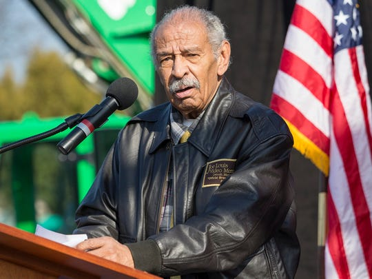 Rep. John Conyers speaks alongside senators and members of the Michigan congressional delegation during a rally at Macomb Community College on Sunday, January 15, 2017 in Warren.