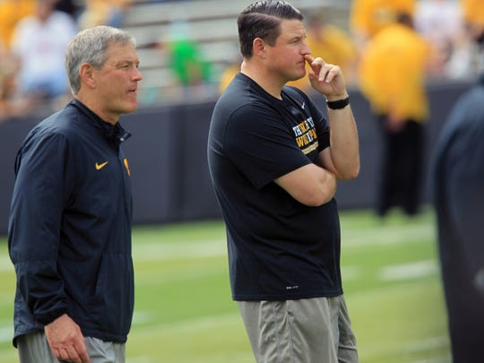 Iowa head coach Kirk Ferentz, left, elevated his son and former offensive line coach, Brian Ferentz right, into the offensive coordinator role. this offseason.