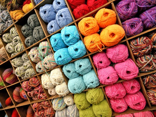 Colorful walls of yarn at the Mass Avenue Knit Shop,