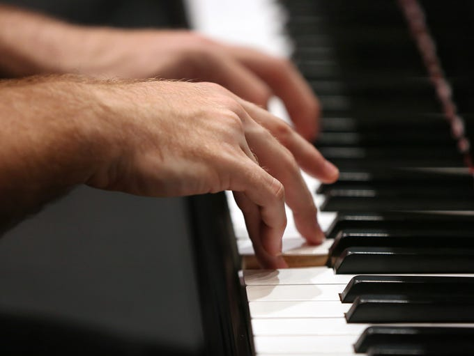Pianist Drew Petersen plays the piano while working