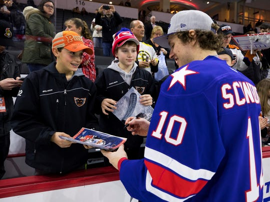 The Rochester Americans' Cole Schneider signs autographs for fans during the AHL All-Star Classic skills competition in Allentown, Pa., on Sunday, Jan. 29, 2017. (Christopher Dolan/The Citizens' Voice via AP)