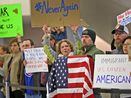 People chant slogans at the Indianapolis International
