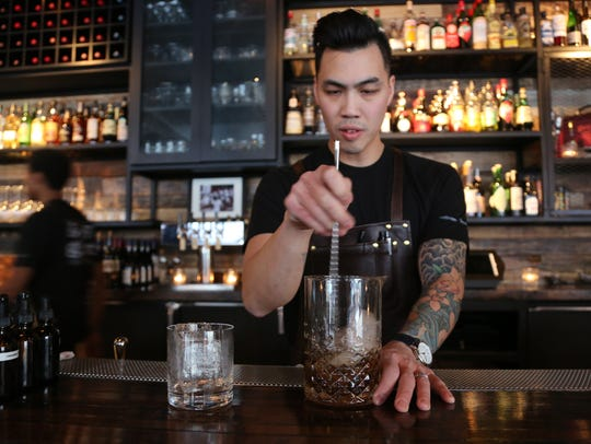 Grey Ghost partner and beverage director Will Lee mixes