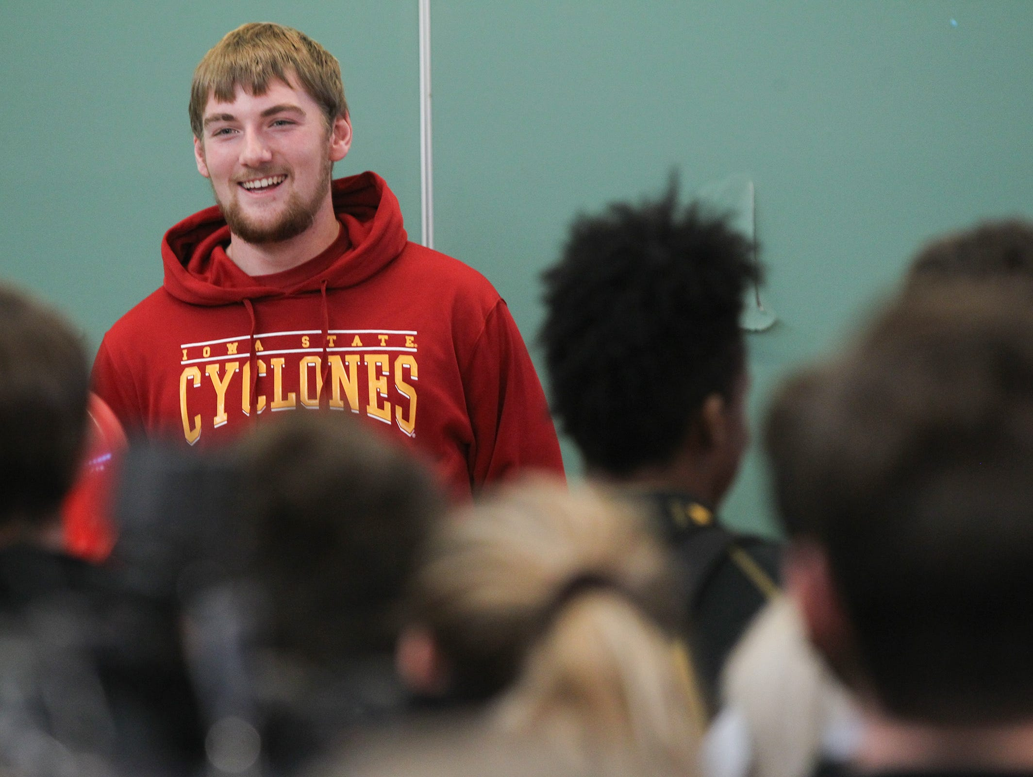 West High senior and Iowa State football recruit Alex Kleinow thanks friends and family during the school's signing day event on Wednesday, Feb. 1, 2017.