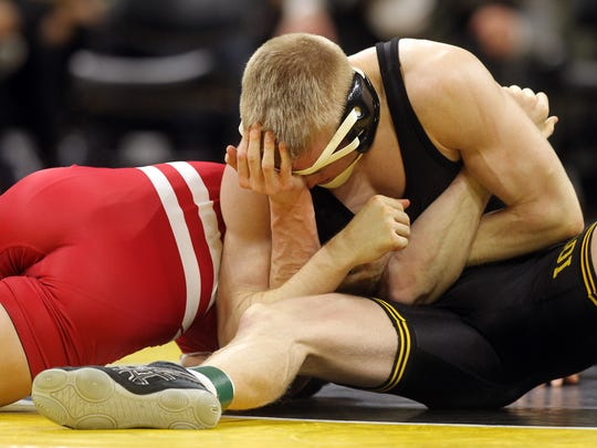 Iowa's Phillip Laux tries to pin Wisconsin's Eli Stickley as they wrestle at 133 pounds at Carver-Hawkeye Arena on Friday, Feb. 3, 2017. Laux won by decision, 6-2.