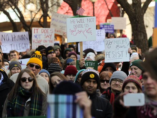 Protesters gather on the pedestrian mall for a rally