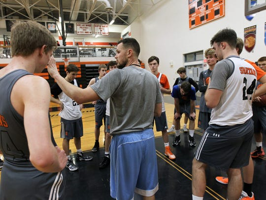 Solon head coach Jason Pershing works with his team