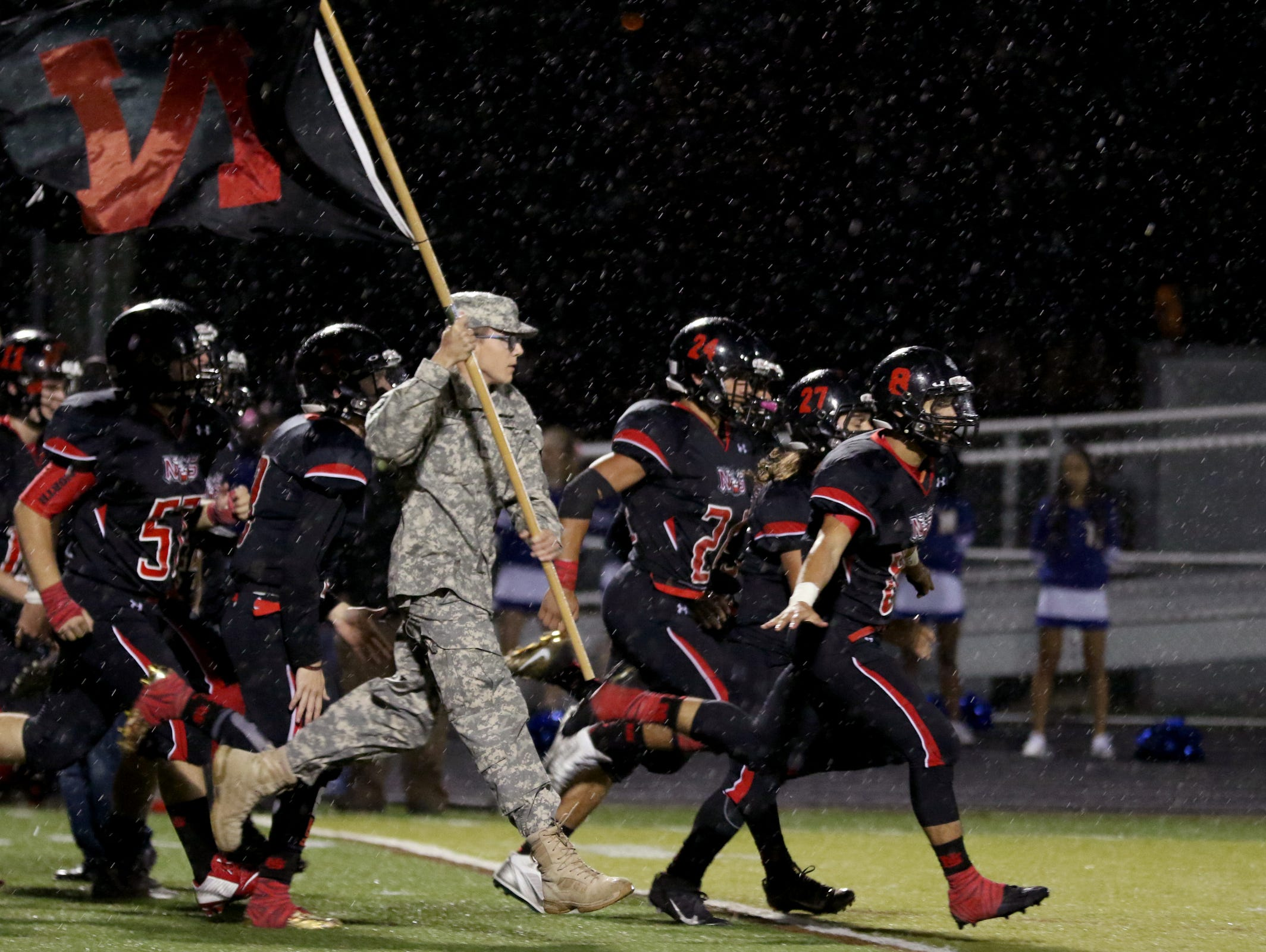 North Salem's football team takes the field before the McKay vs. North Salem football game at North Salem High School on Friday, Oct. 21, 2016.