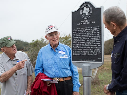 Retired airman Dallas Ford (from left), jokes with Bob Crager and Gordon Stanley, after revealing a Texas Historical Marker for the Rockport Air Force Station on Tuesday, Feb. 7, 2017, at the Aransas County Airport.