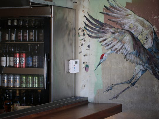 Art by Greg Oberle adorns the scruffy walls of Mabel