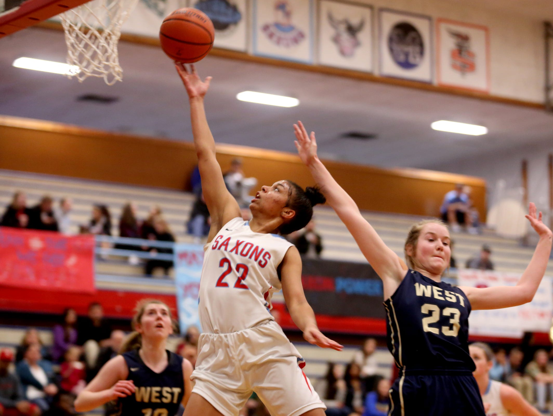 "South Salem's Evina Westbrook (22), who is rated as the top high school guard in the nation by ESPN, said she has a connection on the court with Dani Haley ""that just clicks."""