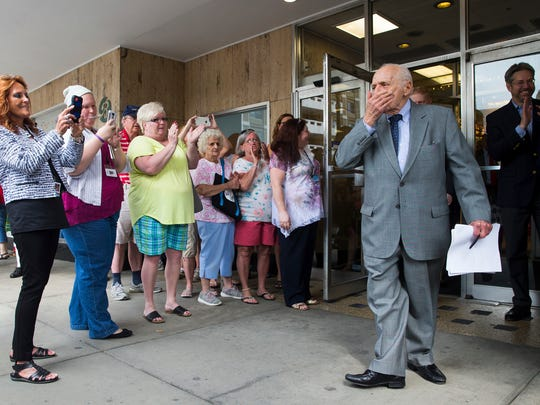 Chairman Albert Boscov blows a kiss to well-wishers at a grand-reopening ceremony for his Boscov's Department Stores in Wilkes-Barre, Pa., on June 4.
