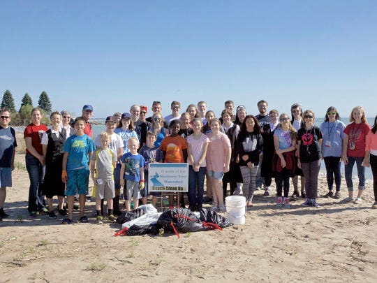 Lasallian Youth student volunteers clean up the Warm Water Beach with the Franciscan Sisters.
