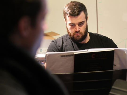 """Carl Rowles rehearses a song with Megan O'Brien and Jack Cottrell (not pictured) for the Old Capitol Opera's performance of """"The Last Five Years"""" on Tuesday, Feb. 14, 2017."""