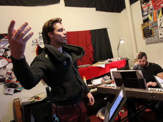 """Jack Cottrell rehearses a song with Carl Rowles and Megan O'Brien (not pictured) for the Old Capitol Opera's performance of """"The Last Five Years"""" on Tuesday, Feb. 14, 2017."""