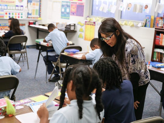 Norma Pizarro teaches math to third, fourth and fifth