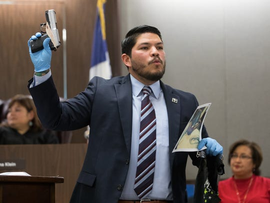District Attorney Mark Gonzalez holds up a gun as he gives his closing argument during the trial of Anthony Molina on Thursday, Feb.16, 2017, at the 214th District Court in Corpus Christi.