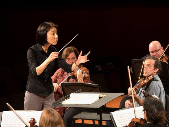 Guest conductor Akiko Fujimoto practices with the Corpus Christi Symphony Orchestra at the Texas A&M-Corpus Christi Performing Arts Center on Thursday, Feb. 16, 2017.