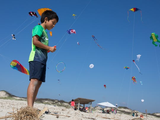 Seven-year-old Augustine Estrada flies a kite during Padre Island National Seashore's sixth annual Kite Day on Saturday, Feb. 18, 2017.