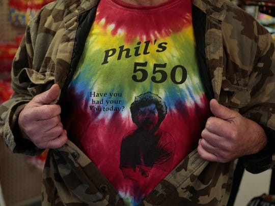 A patron shows the Phil's 550 Store T-shirt that made