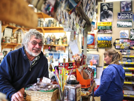 Phil Pearce stands behind the counter at Phil's 550