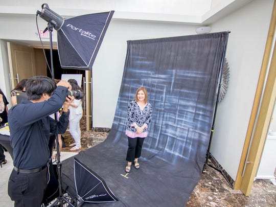 A beauty station with hair, makeup and headshot photography is featured at one of the stations at the Guam Women's Chamber of Commerce Hightide Women's Summit at the Dusit Thani Guam on February 17.