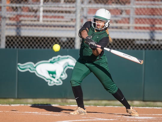 King's Chastity Deleon, seen here hitting in a game last season, will also pitch for the Mustangs in 2017.