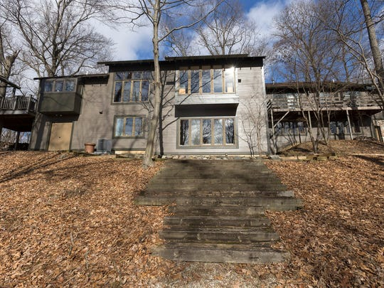 A wooden walkway leads to the back of the house located  in Ann Arbor.