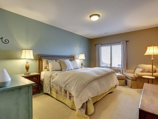 One of two master bedrooms in this Maple Lake home.