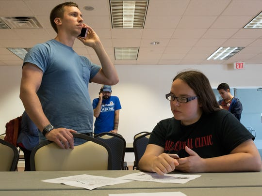"Adam and Kathrine Morris students at Texas A&M University-Corpus Christi Thursday, Feb. 23, 2017, call the office of Texas Senator Juan ""Chuy"" Hinojosa asking him to vote against senate bill 6 known as the bathroom bill."
