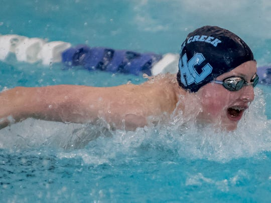 Harper Creek's Alex Piper swims in the 200 Yard IM