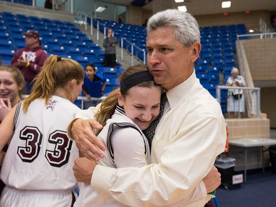 Four Bluff's head coach James McMinn hugs Meredith Marcum after defeating Stephen F. Austin and winning the Region IV-5A Tournament championship game at Northside Spots Gym in San Antonio on Saturday, Feb. 25, 2017.