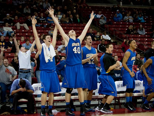 The Germantown bench, including Luke Fischer (40), react as Germantown scores in the closing seconds of its WIAA Division 1 championship victory over Mukwonago on March 9, 2013. Fischer did not lose another game in his career after the Super Tuesday loss in 2011.