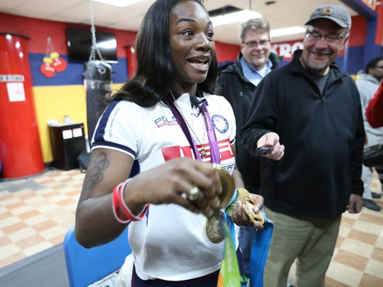 Claressa Shields shows the numerous medals she has