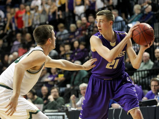 Muscatine's Joe Wieskamp is guarded by West High's Connor McCaffery during their game at the U.S. Cellular Center in Cedar Rapids on Tuesday, Feb. 28, 2017.