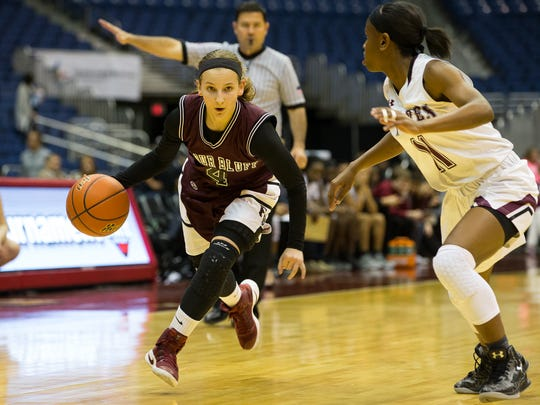 Flour Bluff's Meredith Marcum drives the ball up the court as Mansfield Timberview's Kennedy Wilson guards her  during the third quarter of the Class 5A state semifinal at the Alamodome in San Antonio on Thursday, March. 2, 2017
