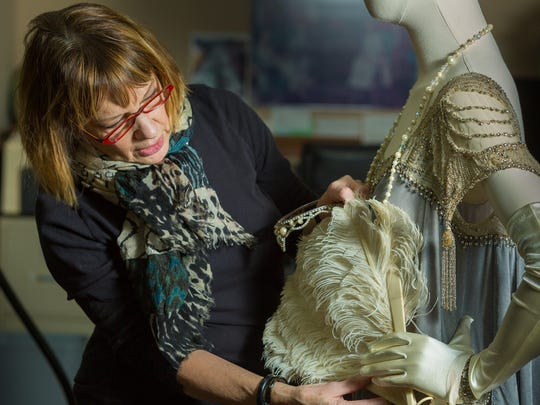 """Broadway dresser Nancy Lawson works on fitting costumes to their mannequins for the 2015 """"Downton Abbey"""" costume exhibition. She did similar work for this year's """"Designed for Drama"""" show."""