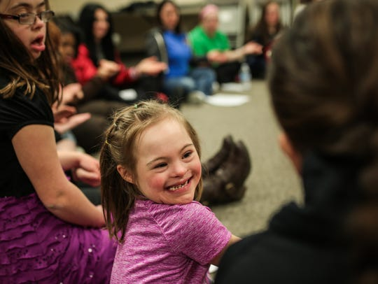 Francesca Bucci, 8, of Lake Orion, smiles after introducing