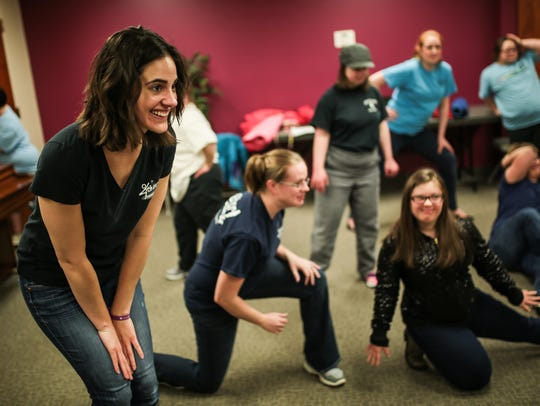 Katie Mann,left, 30, of Livonia, co-founder, dances