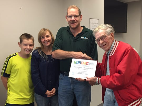 Pictured from left, are the 2016 Vendors of the Year Dakoda, Colleen, and Wayne Lubbert with Clifford Sweet, the 2014 Vendor of the Year.