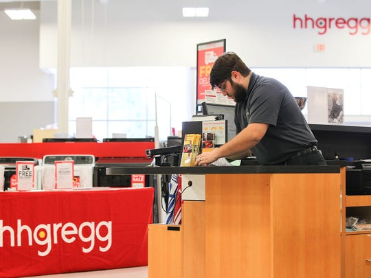 Nick Thrasher, a customer service representative, works Tuesday inside the hhgregg in Anderson.