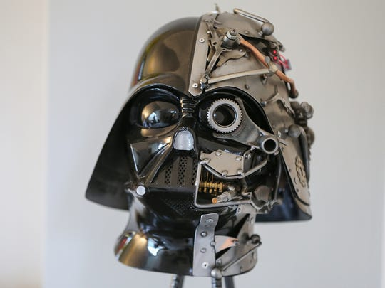 A steampunk Darth Vader piece by artist Adam Homan is in the living room of the penthouse.
