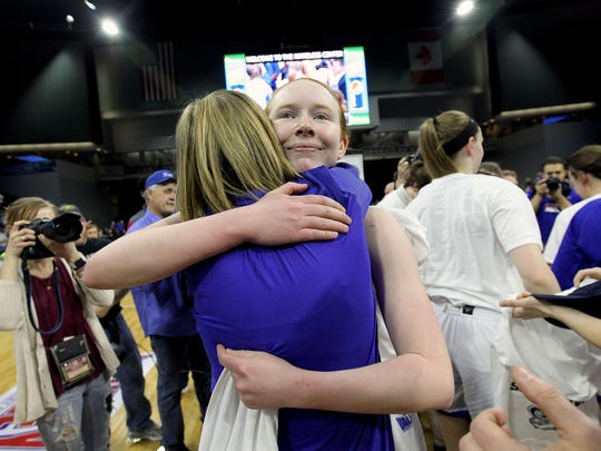 Drake's Becca Hittner gets a hug from head coach Jennie